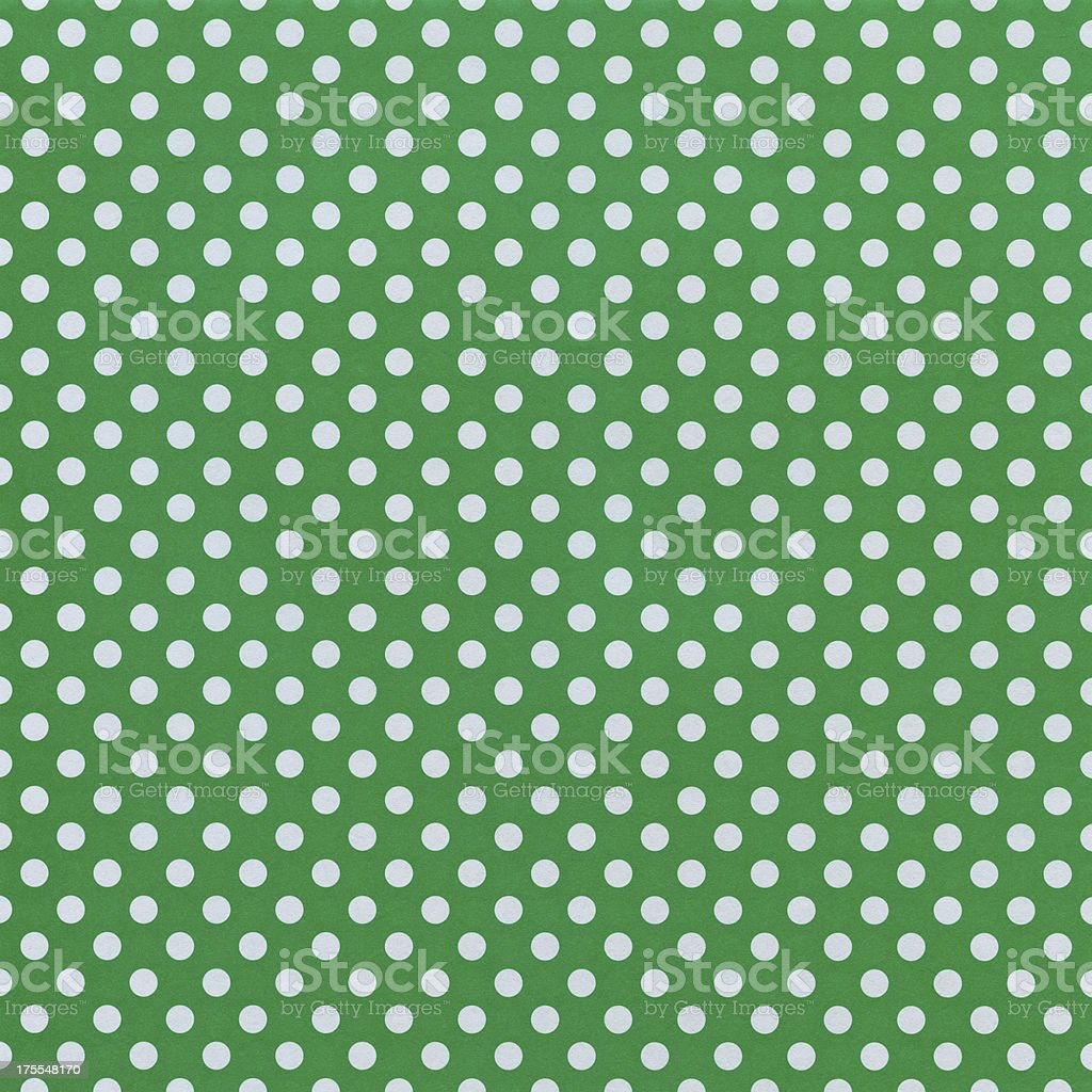 White Paper with Green Dots stock photo