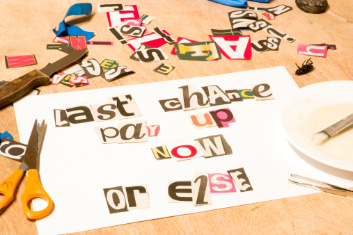 A White Paper With Magazine Clips Forming Words Stock Photo - Download Image Now