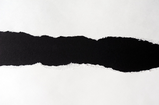 White paper with torn edges isolated with black colored paper background inside. Good paper texture