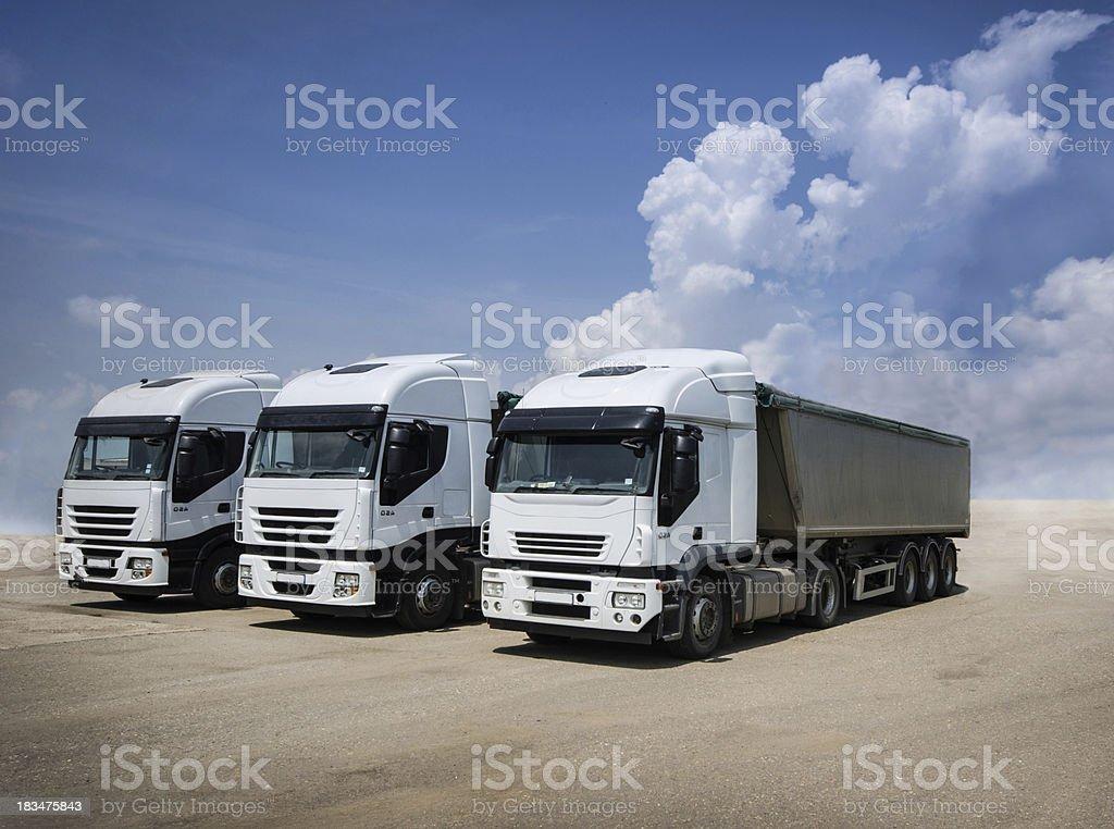white parked trucks stock photo