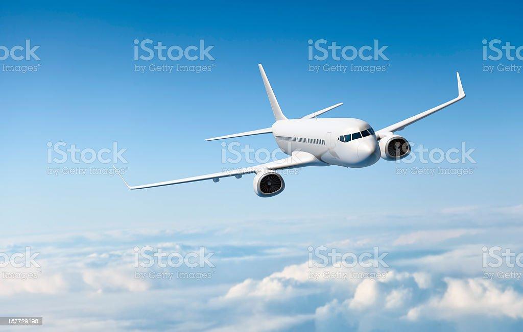 White Passagier Flugzeug fliegen über den Wolken – Foto