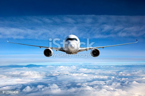 istock White passenger airplane in the sky. 912360406