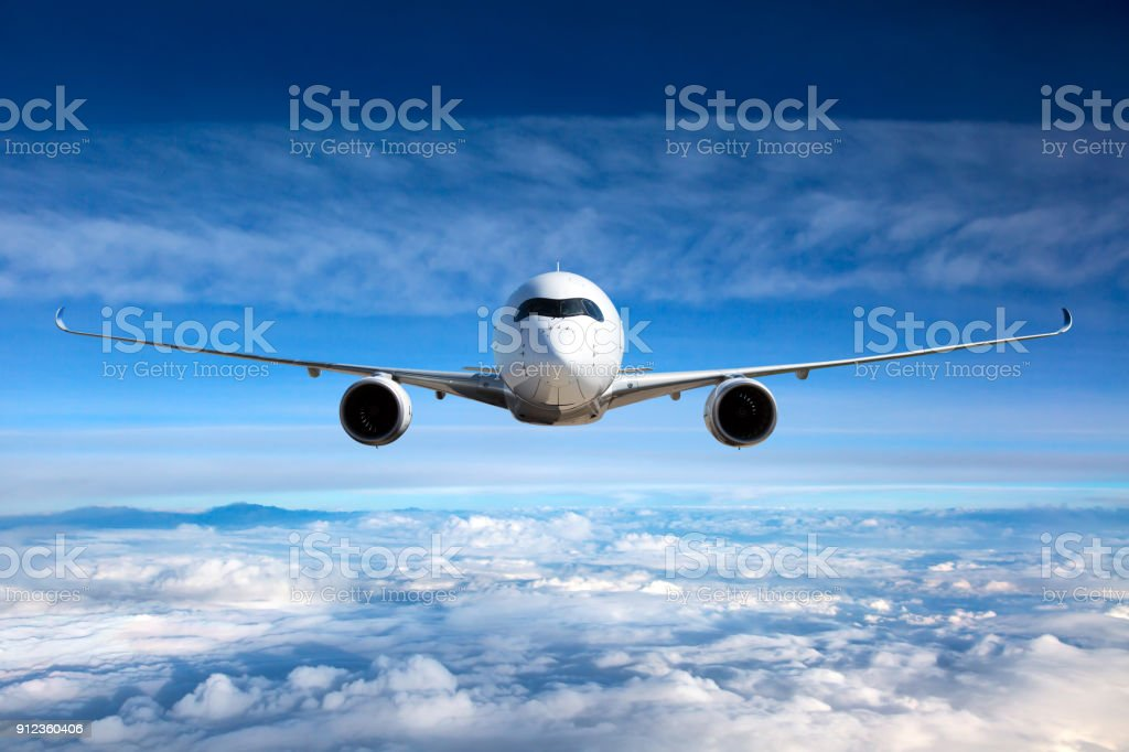 White passenger airplane in the sky. stock photo