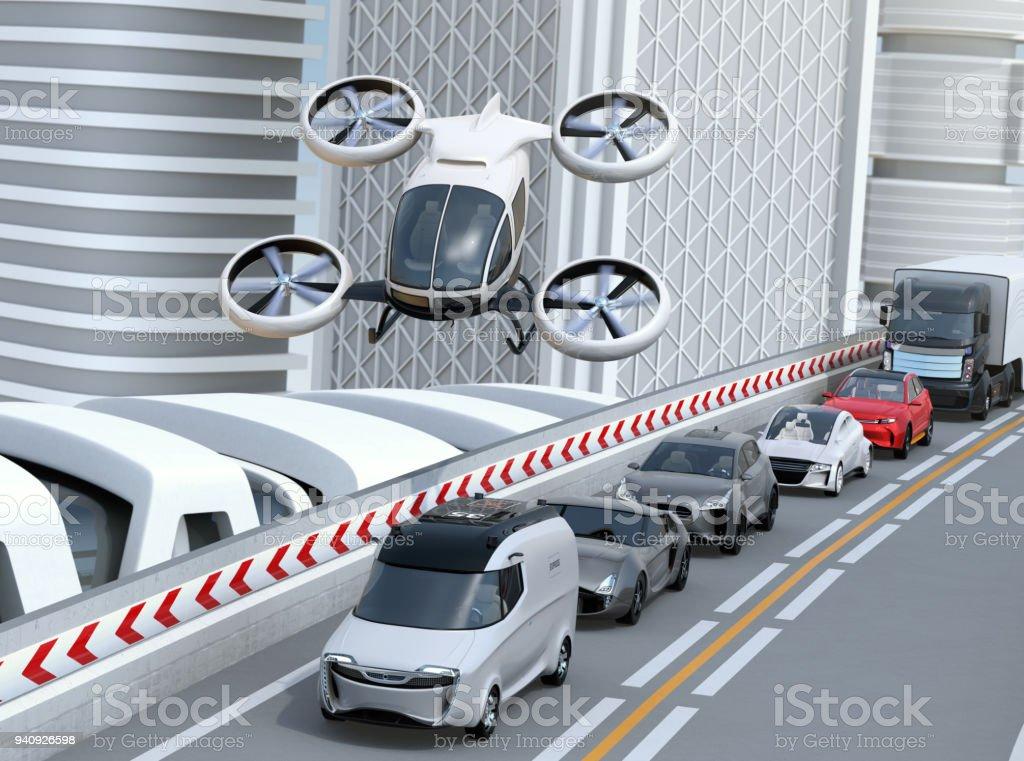 White passenger drone flying over cars in heavy traffic jam stock photo