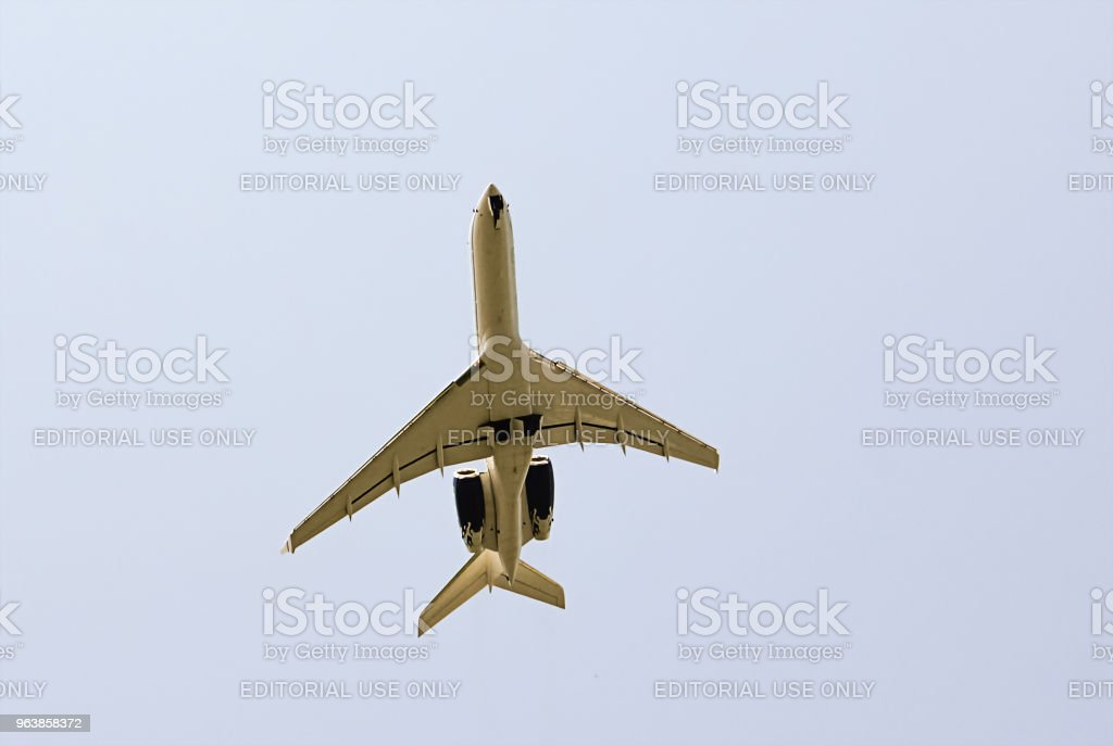 white passenger plane Tu-154 flies high in the sky, a flying machine in the air comes to land. Russia, Sochi July 2011 - Royalty-free Aerospace Industry Stock Photo