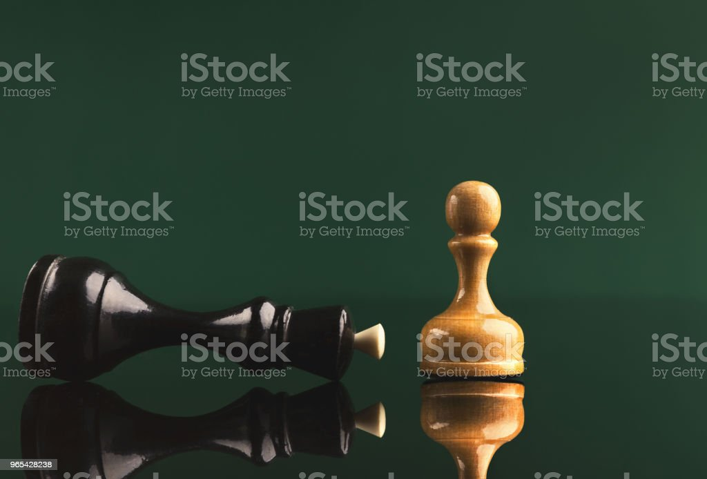 White pawn has got victory under black queen royalty-free stock photo