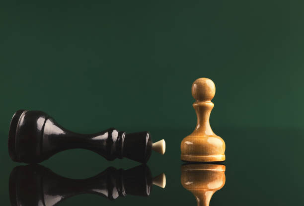 white pawn has got victory under black queen - decrepitude stock pictures, royalty-free photos & images