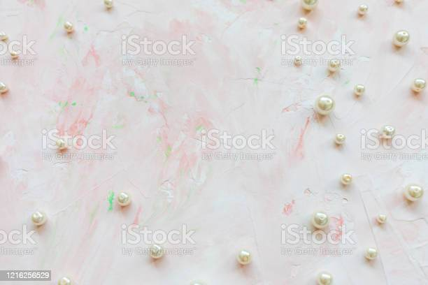 White pearls on pink creative abstract background picture id1216256529?b=1&k=6&m=1216256529&s=612x612&h=hhhe6bbo5x9hzct zd7bfy4oaw5lq etd7rxxhwilra=
