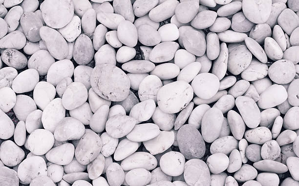 White pebbles background stock photo