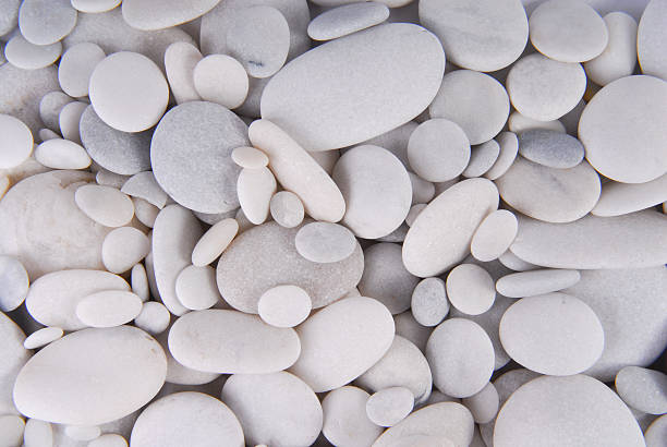 white pebbles stones background stock photo