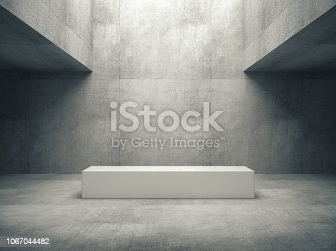 istock White pedestal for display,Platform for design,Blank product stand with raw concrete room. 1067044482