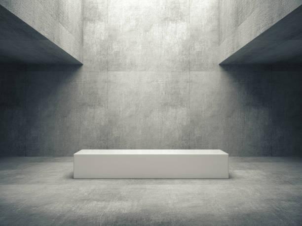 white pedestal for display,platform for design,blank product stand with raw concrete room. - museu imagens e fotografias de stock