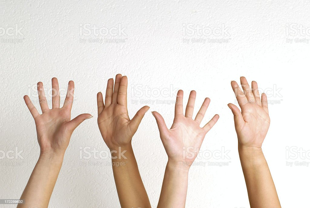 White people raising their hands  royalty-free stock photo