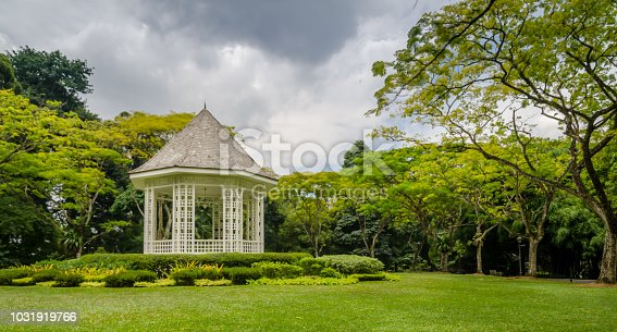 The Gazebo or Bandstand as the focus point of the background of green trees and grass.
