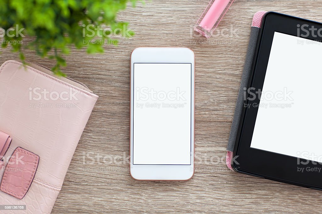 white phone with isolated screen and e-rider on women table stock photo