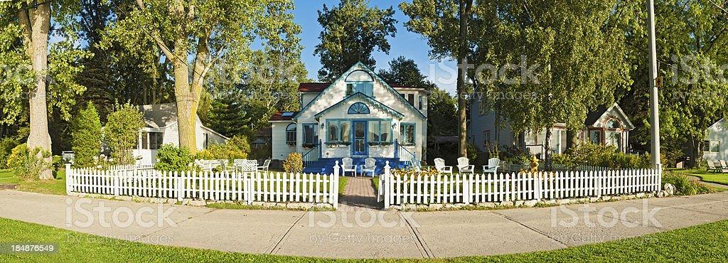 White picket fence idyllic wooden home garden panorama stock photo