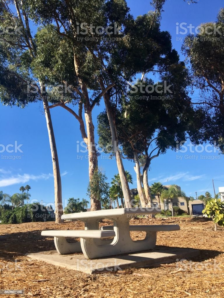 White picnic table in the park stock photo
