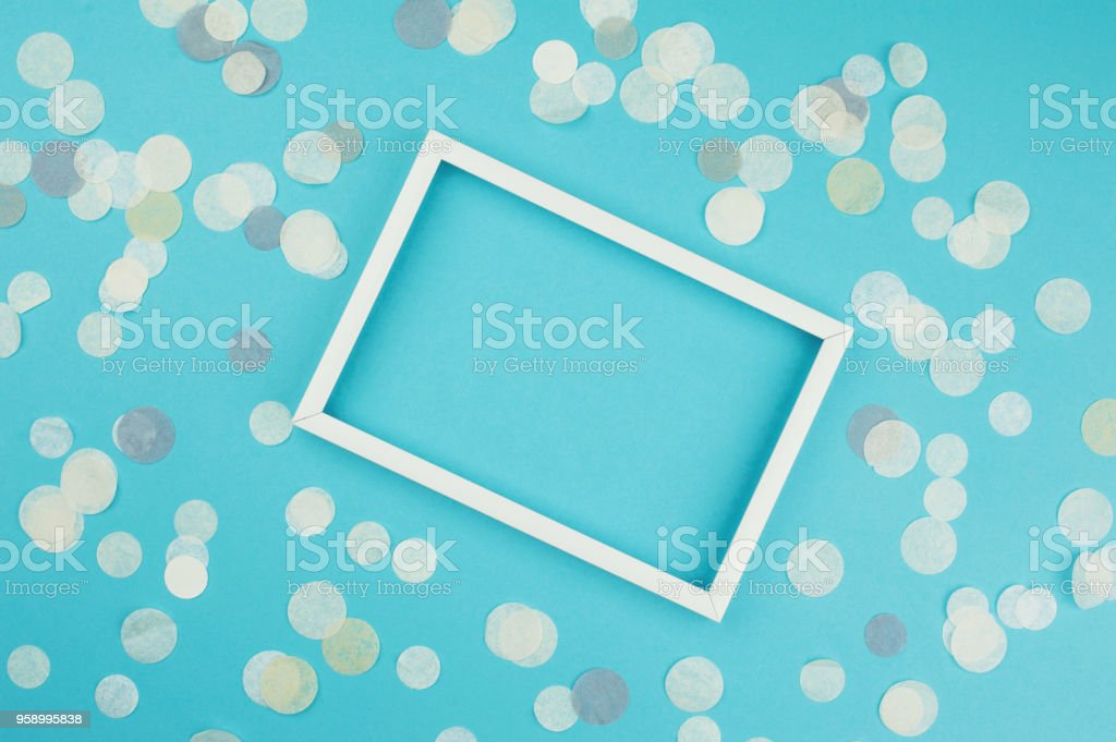 White picture frame and confetti on blue background top view flat white picture frame and confetti on blue background top view flat lay mockup stopboris Image collections