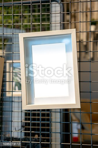 istock White picture frame mock up hanging on metal frame 1035273112