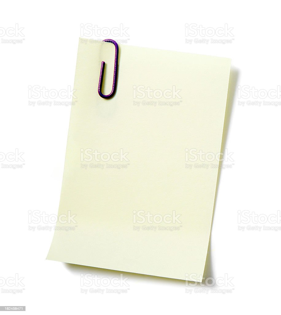 White piece of paper held by a paperclip royalty-free stock photo