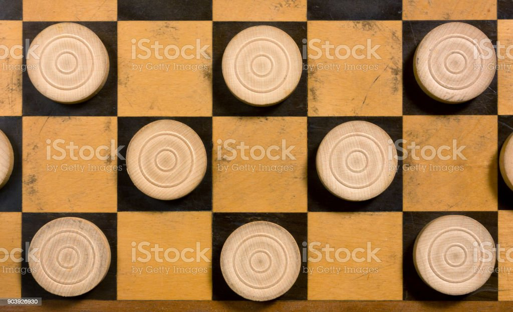 White Pieces on a Checkerboard stock photo