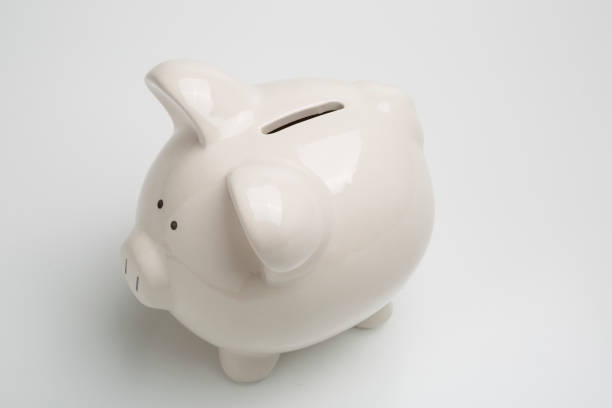 A white piggy bank for college, vacation, investments, car, home and rainy day savings stock photo