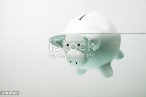 istock White piggy bank sinking in water 170619460