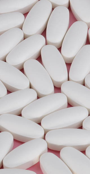 white pill on pink background white pill on pink background deleterious stock pictures, royalty-free photos & images