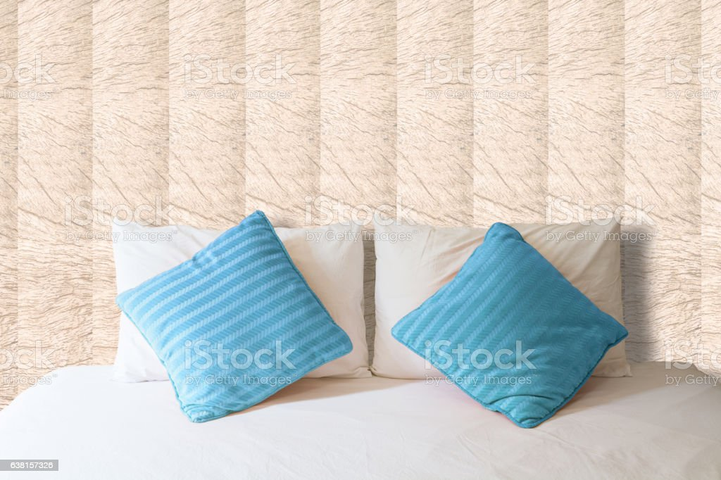 white pillow and brown pillow on bed and with blanket stock photo