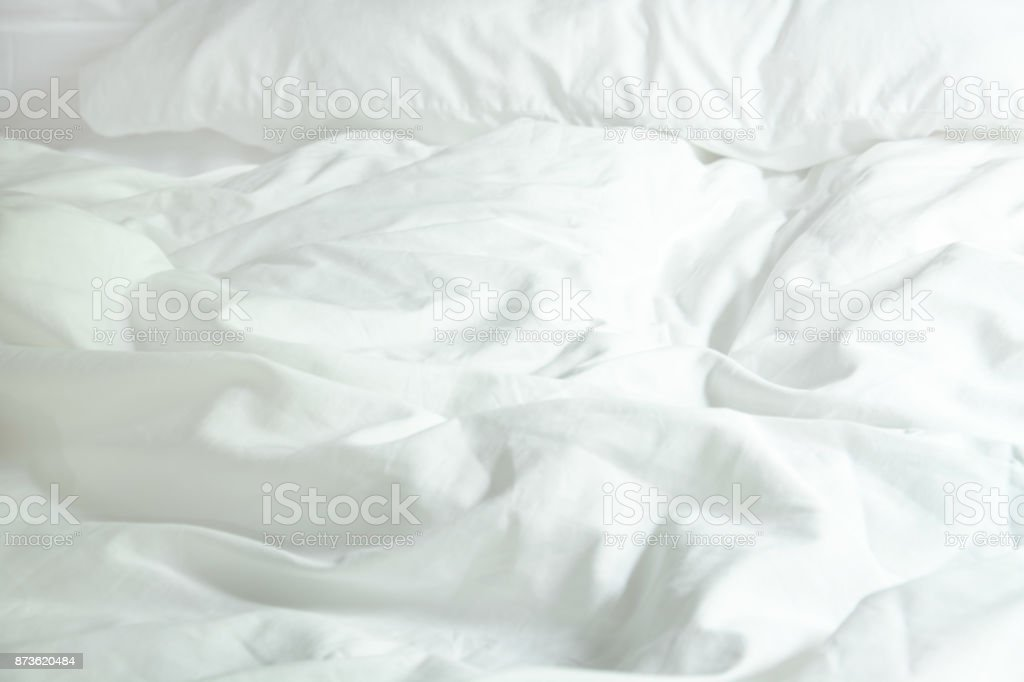 White Pillow On Bed And With Wrinkle Messy Blanket In Bedroom, From Sleeping In A Long Night Winter. stock photo