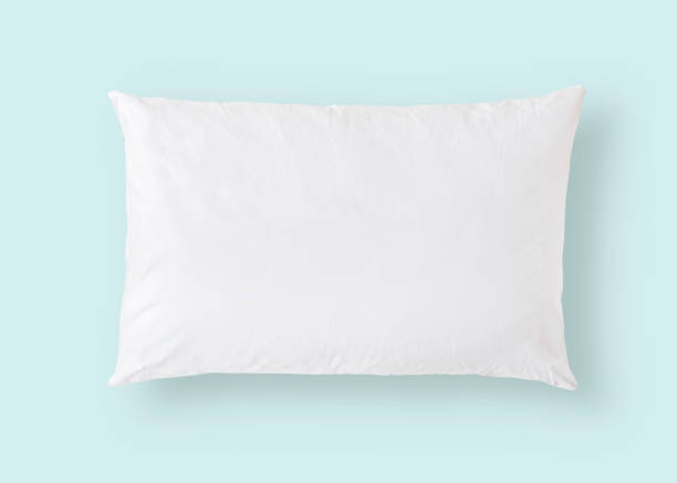 white pillow on blue background isolated with clipping path for bedding mockup design template - подушка стоковые фото и изображения
