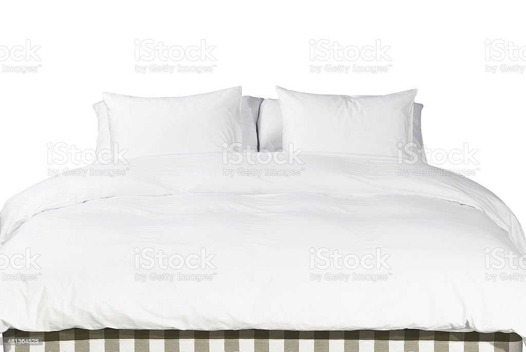 White pillows and blanket on a bed stock photo