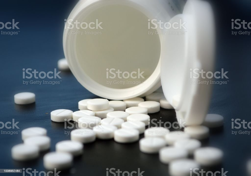 White pills and pill box stock photo