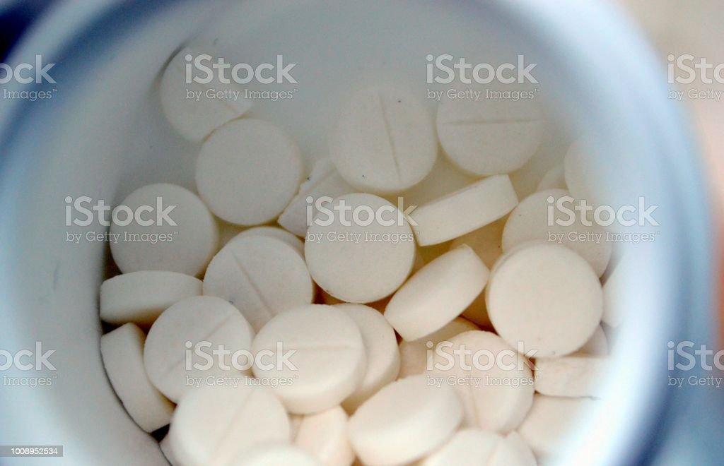 White pills and pill box stock photo