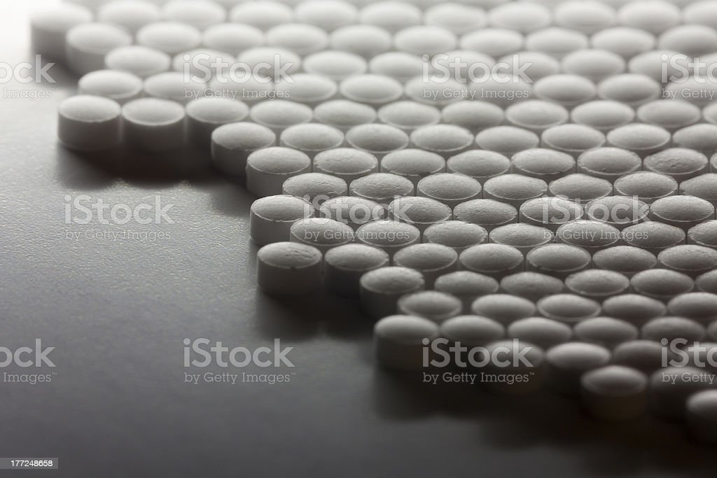 White Pills In a Geometric Pattern royalty-free stock photo
