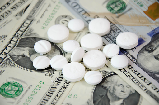 white pills lie on dollars. expensive medicine. High quality photo