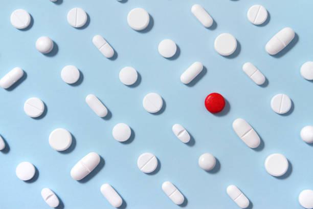 White Pills on Blue Background stock photo