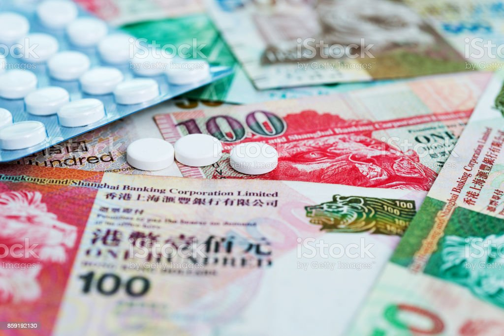 White pills on Hong Kong currency stock photo