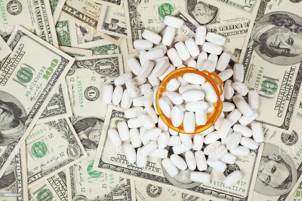 White pills on money royalty-free stock photo