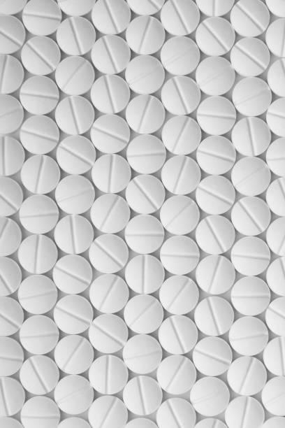 beyaz hap. tabletler desen makro. - tablet stok fotoğraflar ve resimler