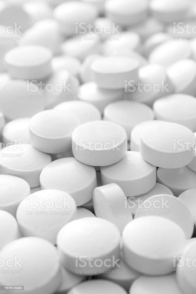 White pills stock photo