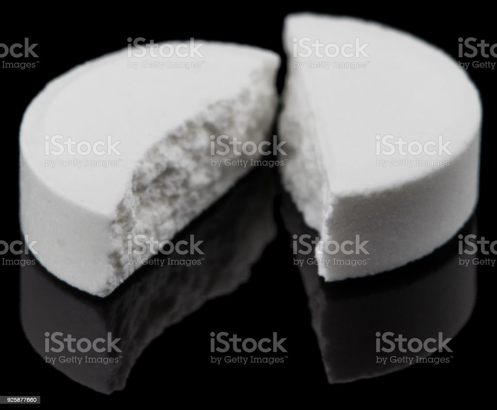 White pills that have expired. stock photo