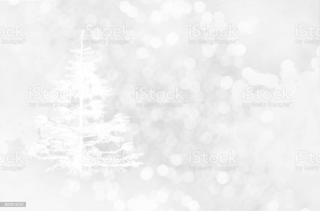 white pine Christmas tree with glitter light snow bokeh winter background stock photo