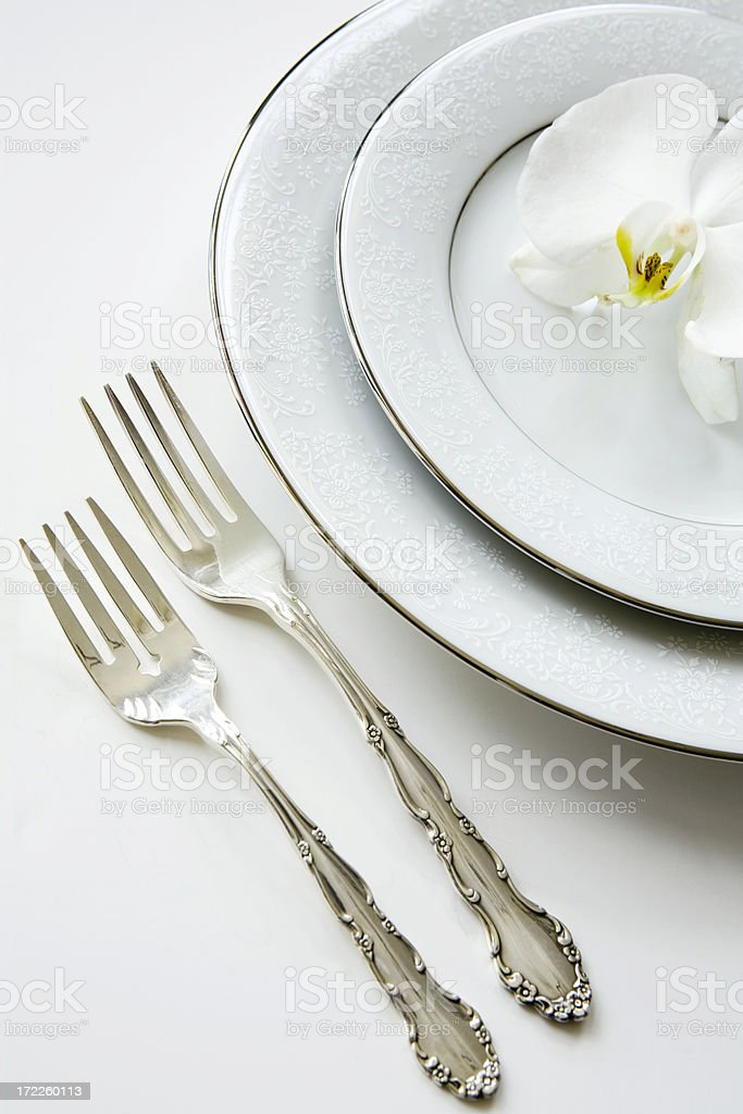 white placesetting with orchid royalty-free stock photo
