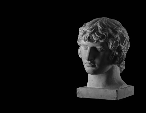 White plaster bust sculpture portrait of a young man