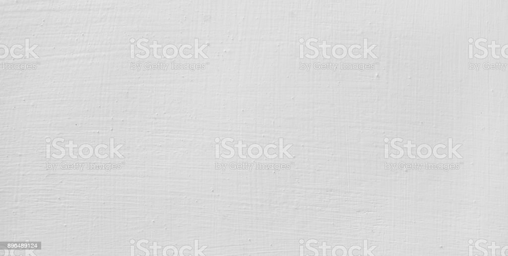 White plaster wall background with small scratches. stock photo