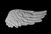istock white plaster wing on a black background 873245554
