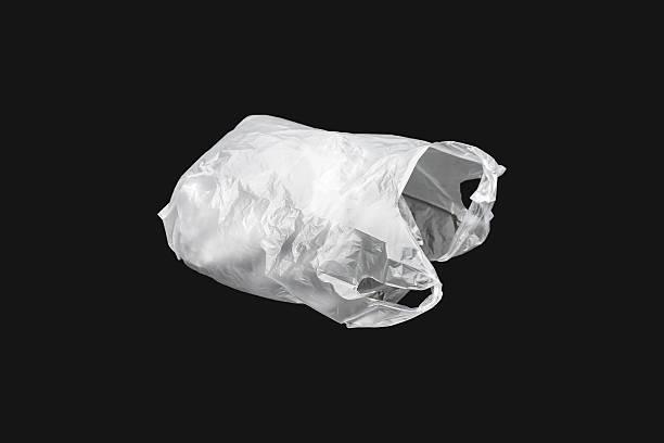 weiße kunststoff-tasche - windbeutel stock-fotos und bilder