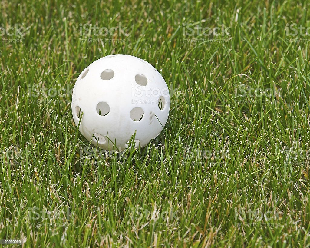 White plastic ball on green grass stock photo