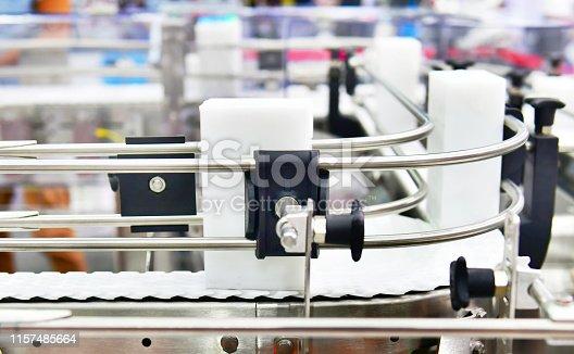 White plastic box on conveyor belt.parcels transportation system concept